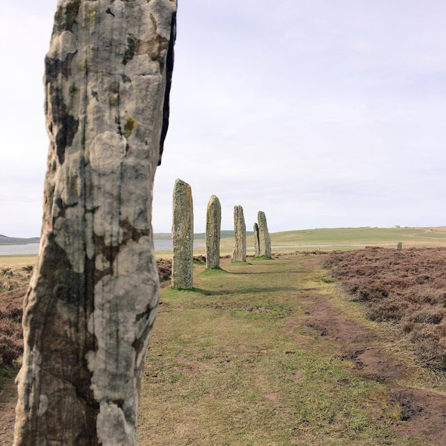 The Ring of Brodgar, one of the stones is at the left forefront of the image and 5 stones behind.
