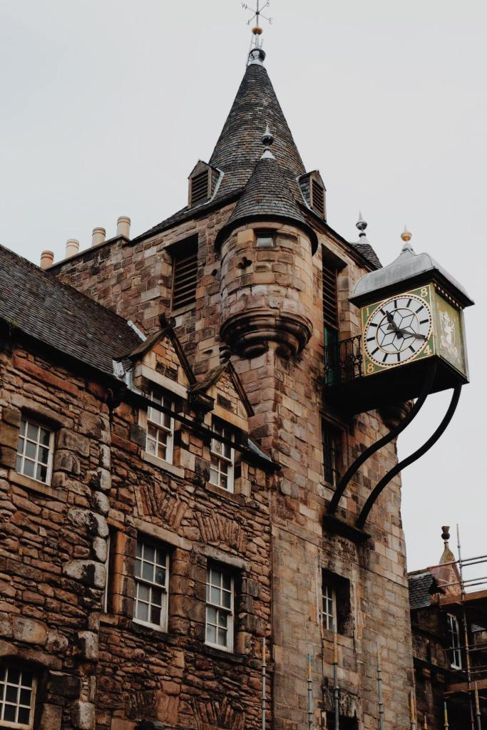 The Tolbooth building with clock tower which houses the People's Story Museum. The brown building has two turrets, and the clock (showing the time 20 past 11) is in a green cube with a white face.
