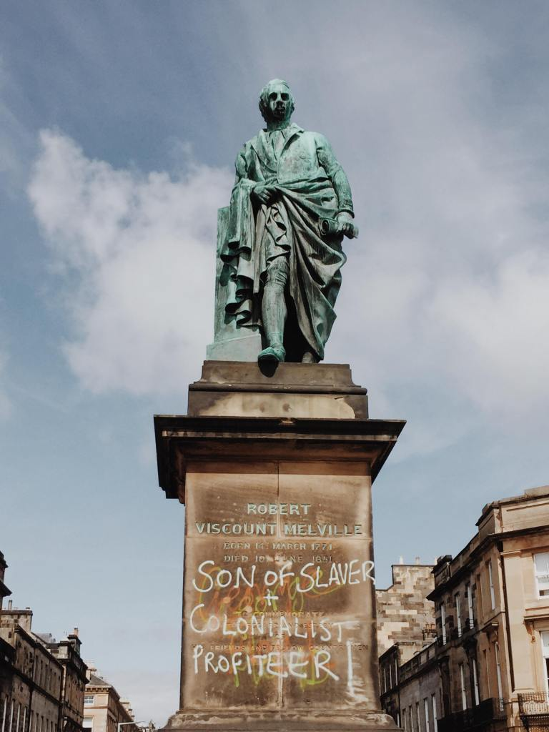 Robert Viscount Melville Statue in Edinburgh with graffiti 'son of slaver and colonialist' 'profiteer'