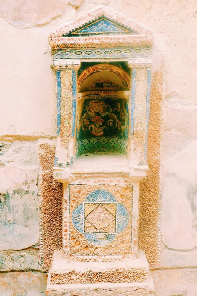 Mosaic shrine in Herculaneum, Naples. The niche is filled with blue and green tessera.