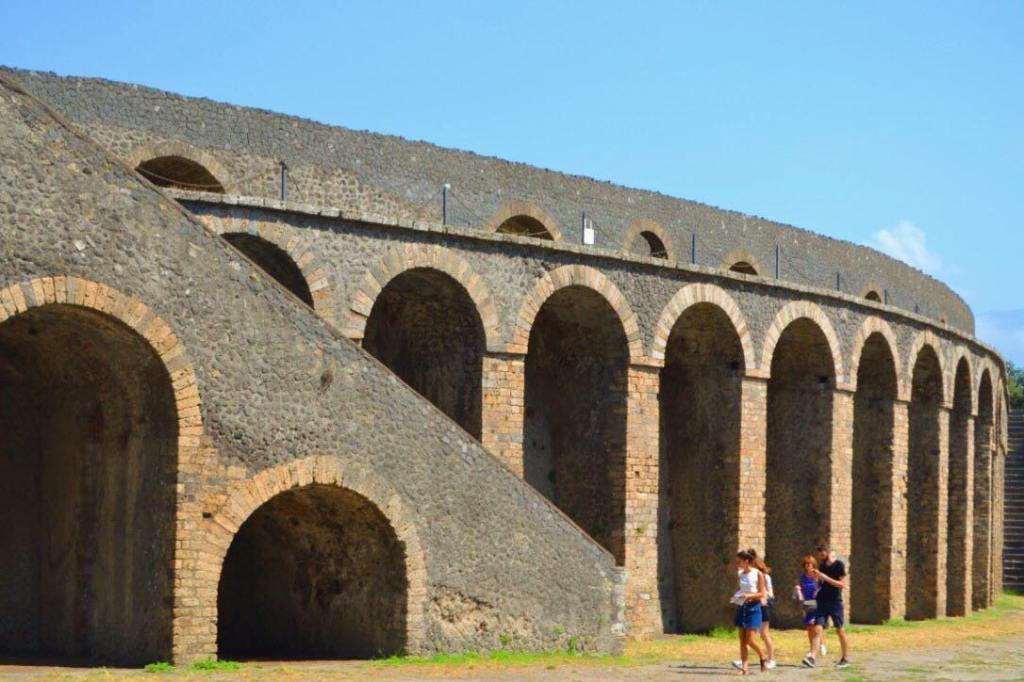 The amphitheater at Pompeii with arched entrance