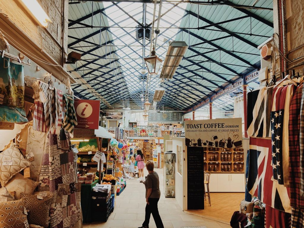 The interior of Durham Market hall with trade  stalls.