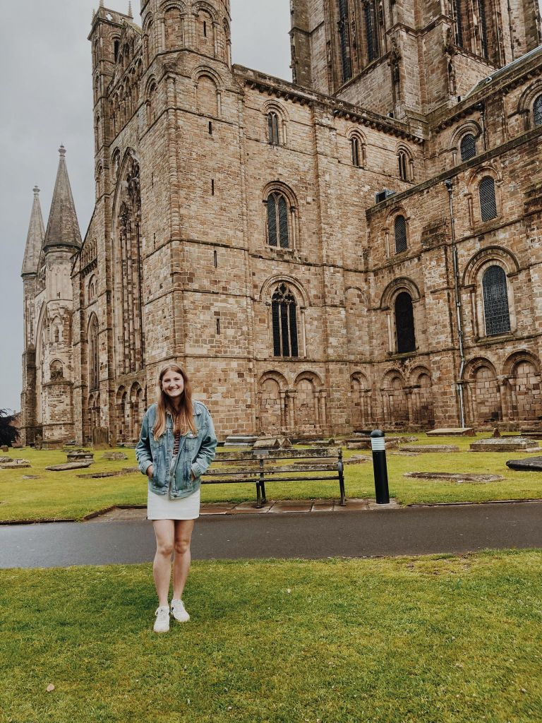 Emily (The Heritage Tourist) standing in front of Durham Cathedral.