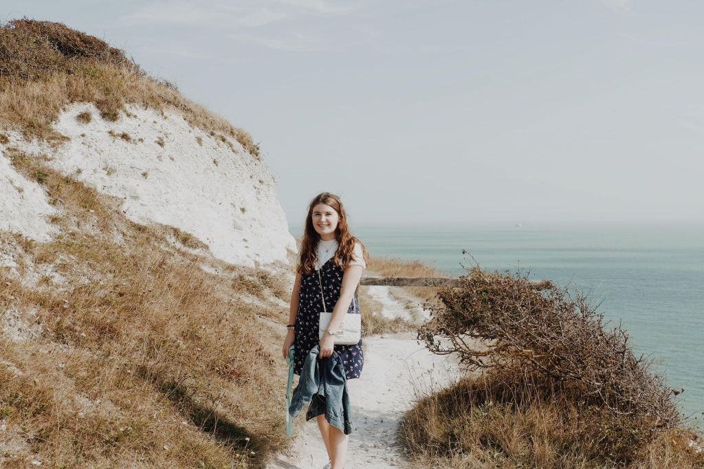 Eleanor standing on the white cliffs of dover, England