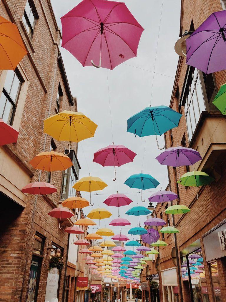Durham City Centre, colourful umbrellas lining the street.